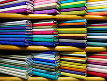 shopping-style-fabric-stores-rolls-of-fabric