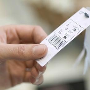 customer looking at shopping tag
