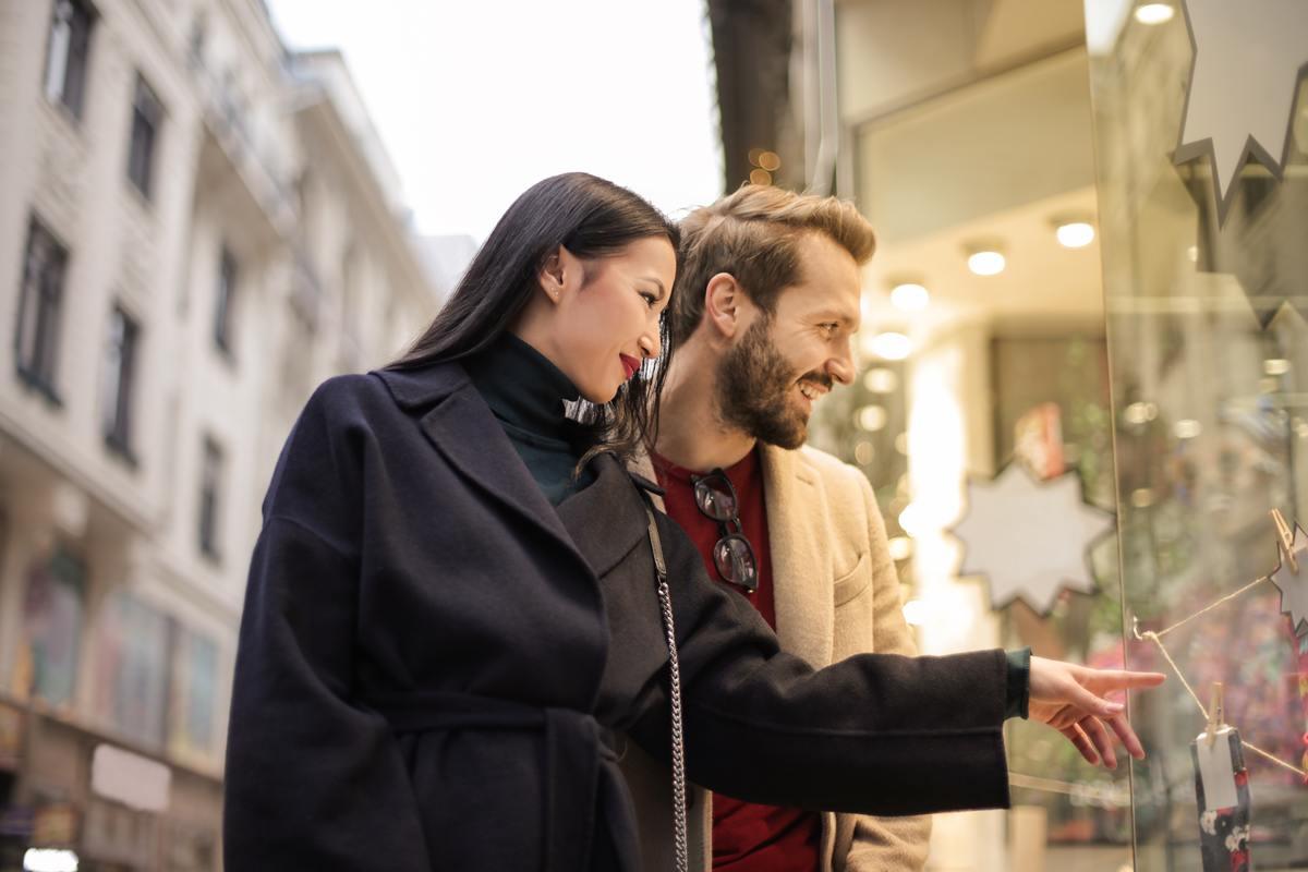 man-in-brown-coat-standing-beside-woman-in-black-coat-3775548