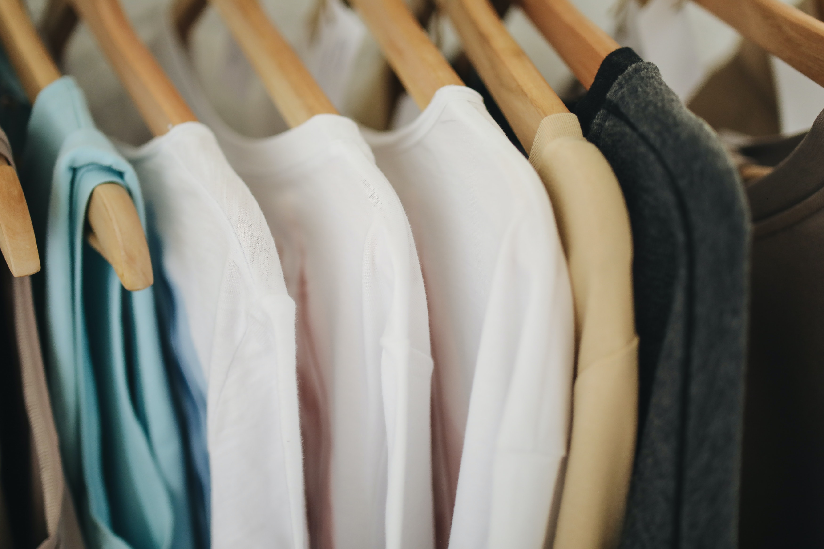 white-long-sleeves-shirts-on-brown-wooden-clothes-hanger-3735641